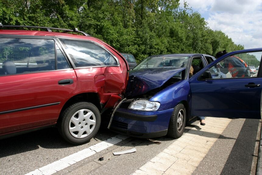 Blue car in a rear-end accident with a red car